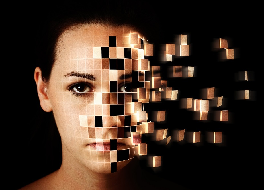 transitioning from analog to digital - image of face disintegrating into squares