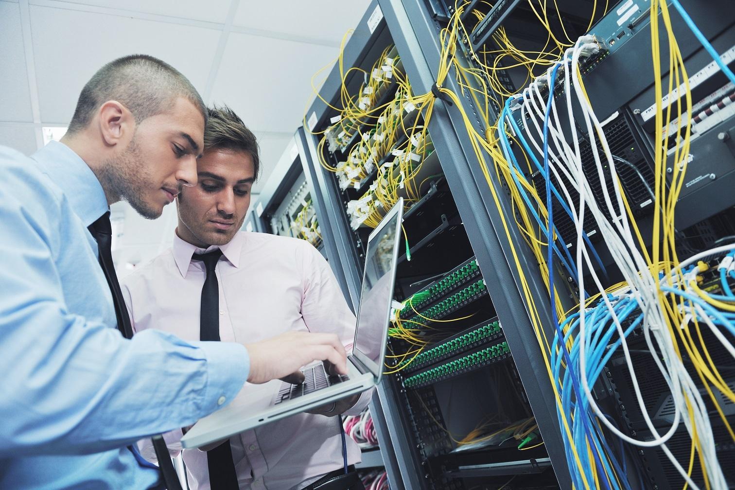 businessmen in a network server room
