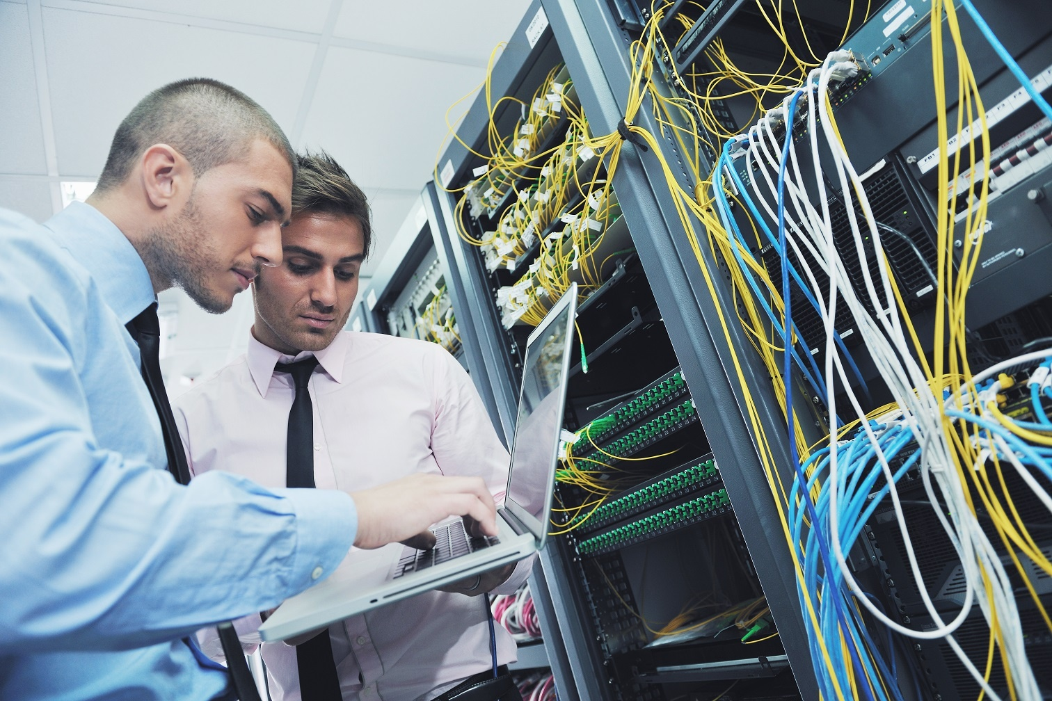 businessmen in a network server room