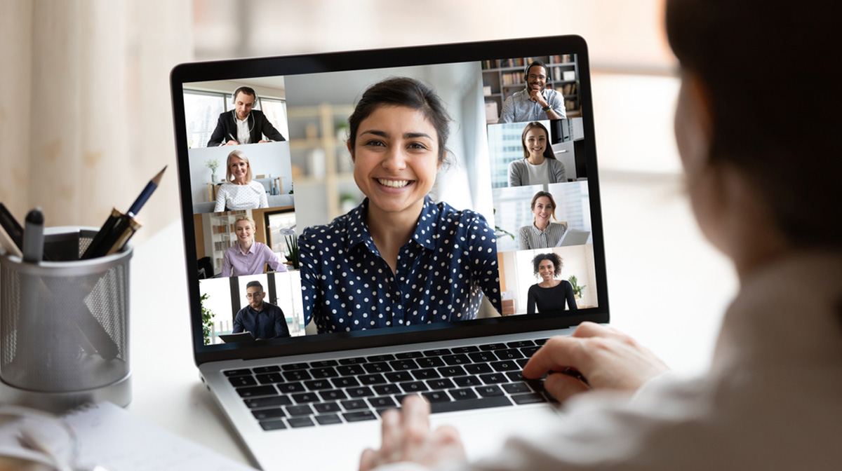 woman participating in a videoconference on her laptop