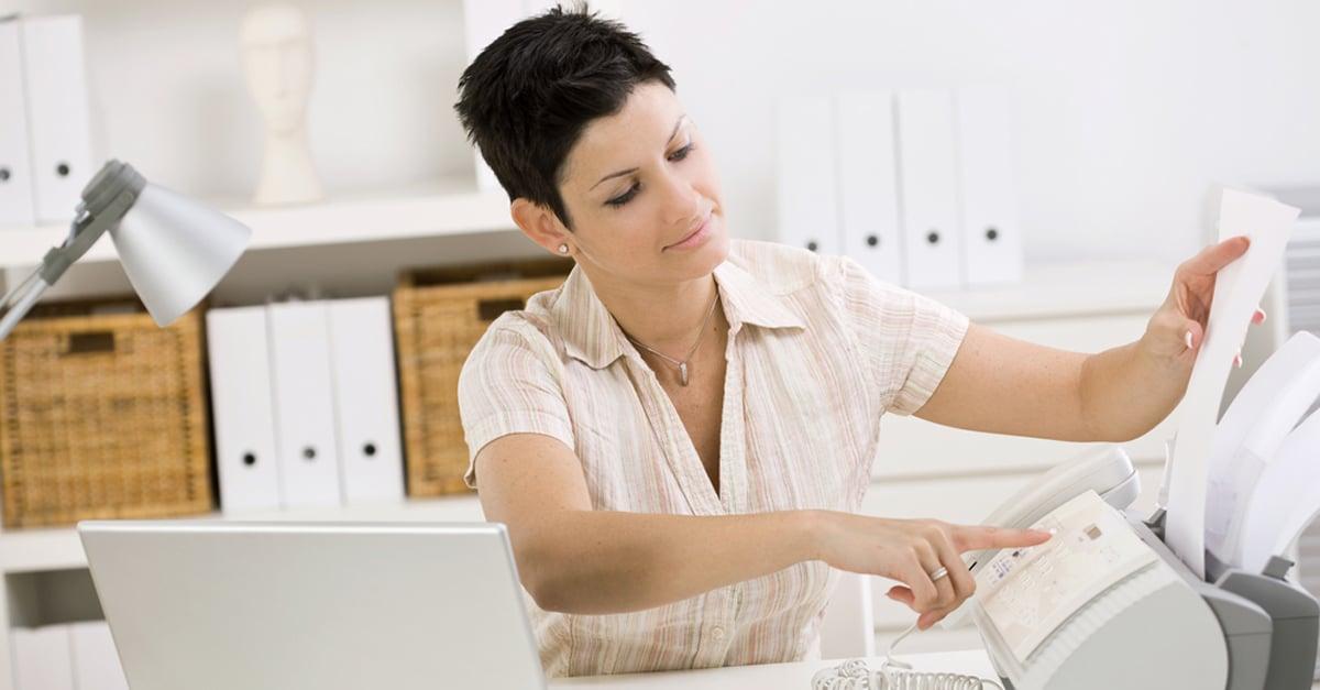 woman at a fax machine