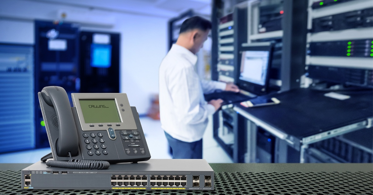 man in a data center room