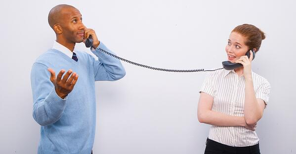 two colleagues talking on the phone
