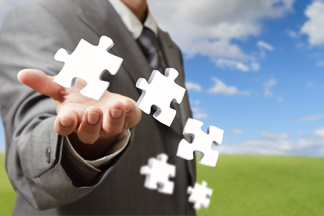 businessman-hand-and-business-puzzles-as-concept_M10n5trd-25pct.png
