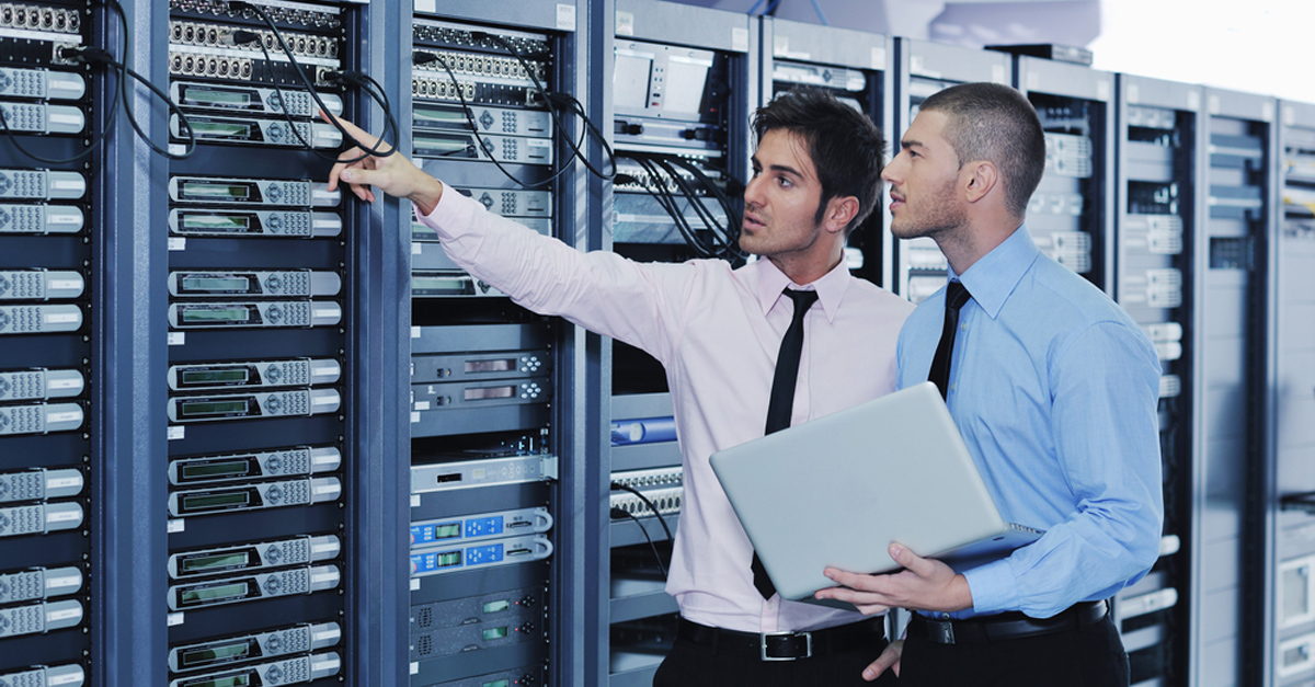 network engineers in a server room