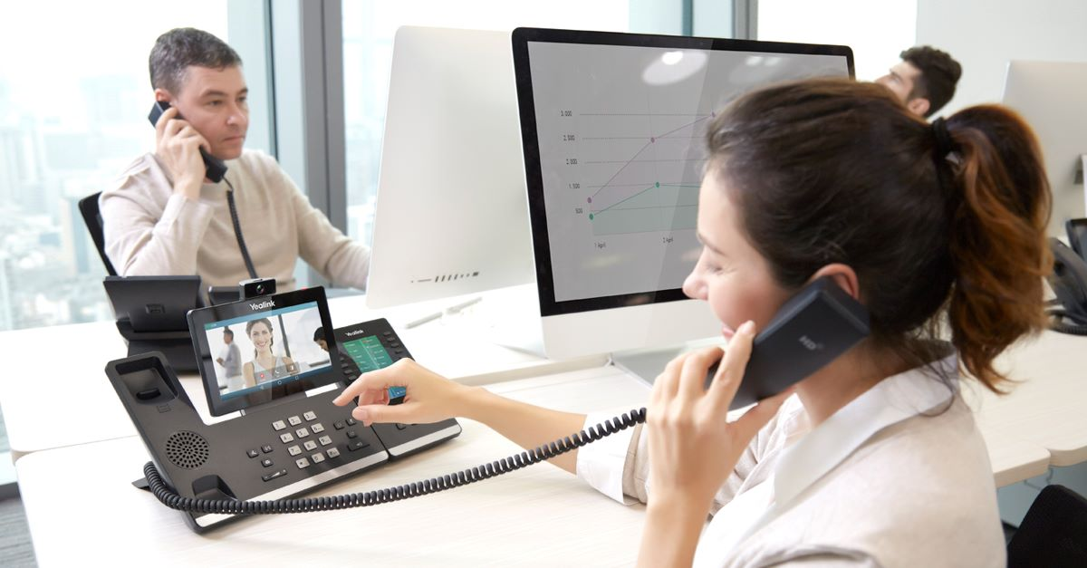 executive using the Yealink VP59 smart IP video phone at the office