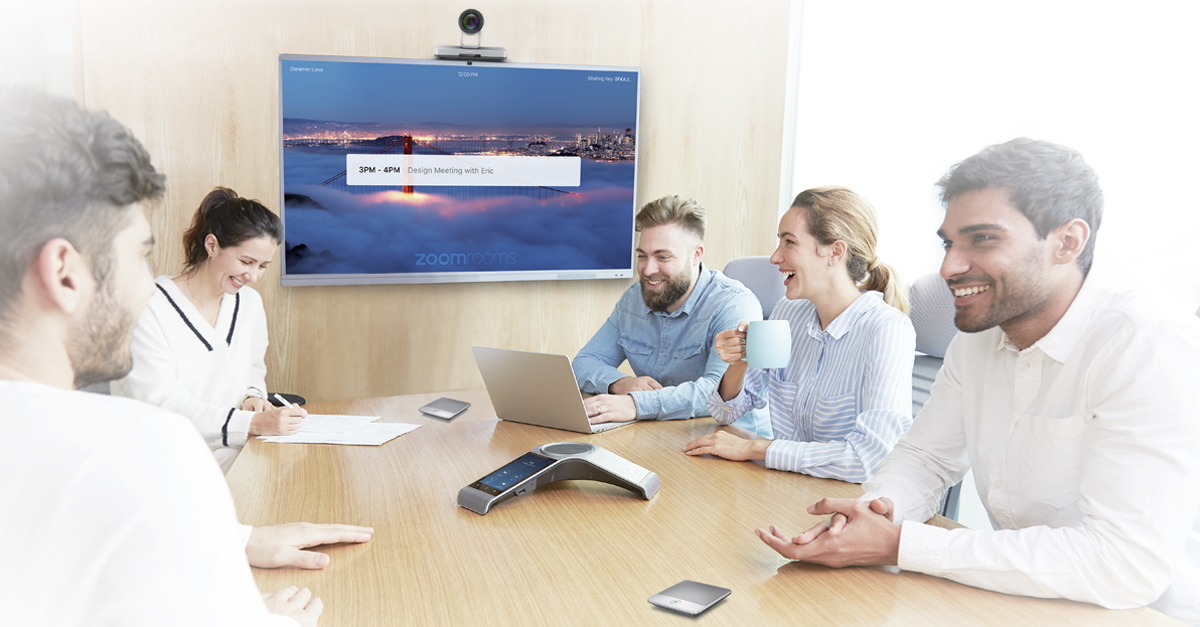 People in a meeting room using Yealink's CP960-UVC Zoom Rooms Kit